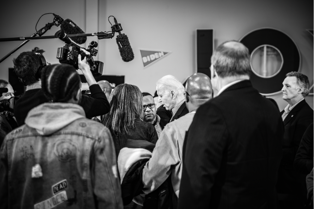 Reporters and supporters surround Joe Biden following a rally in Sumter, South Carolina. Photo Lance Monotone.