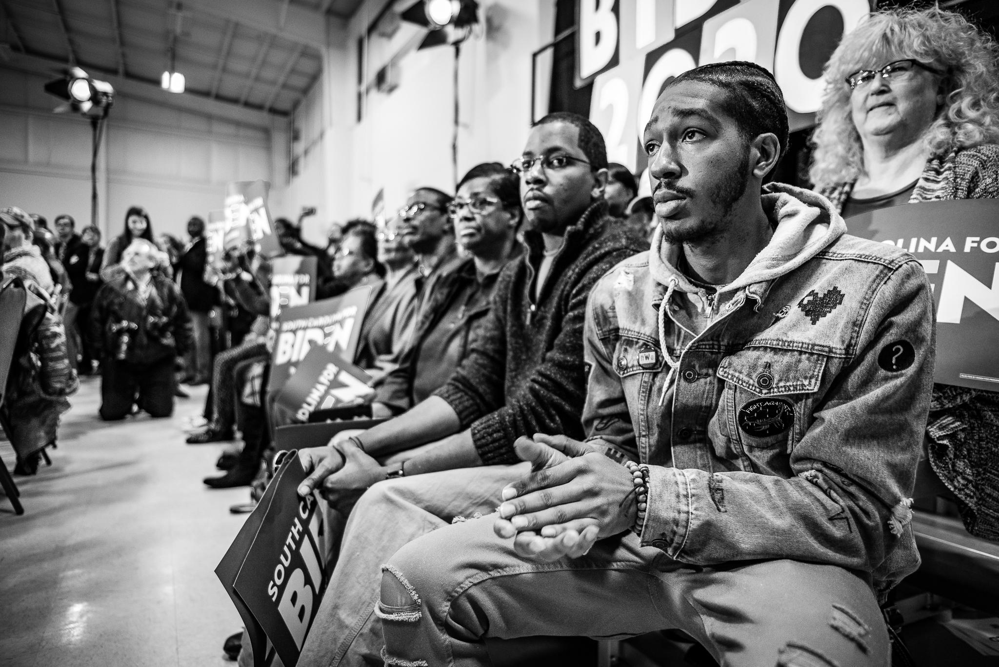 Supporters in Sumter South, Carolina look on as Joe Biden gives a stump speech. February 28, 2020. Photo: Lance Monotone.