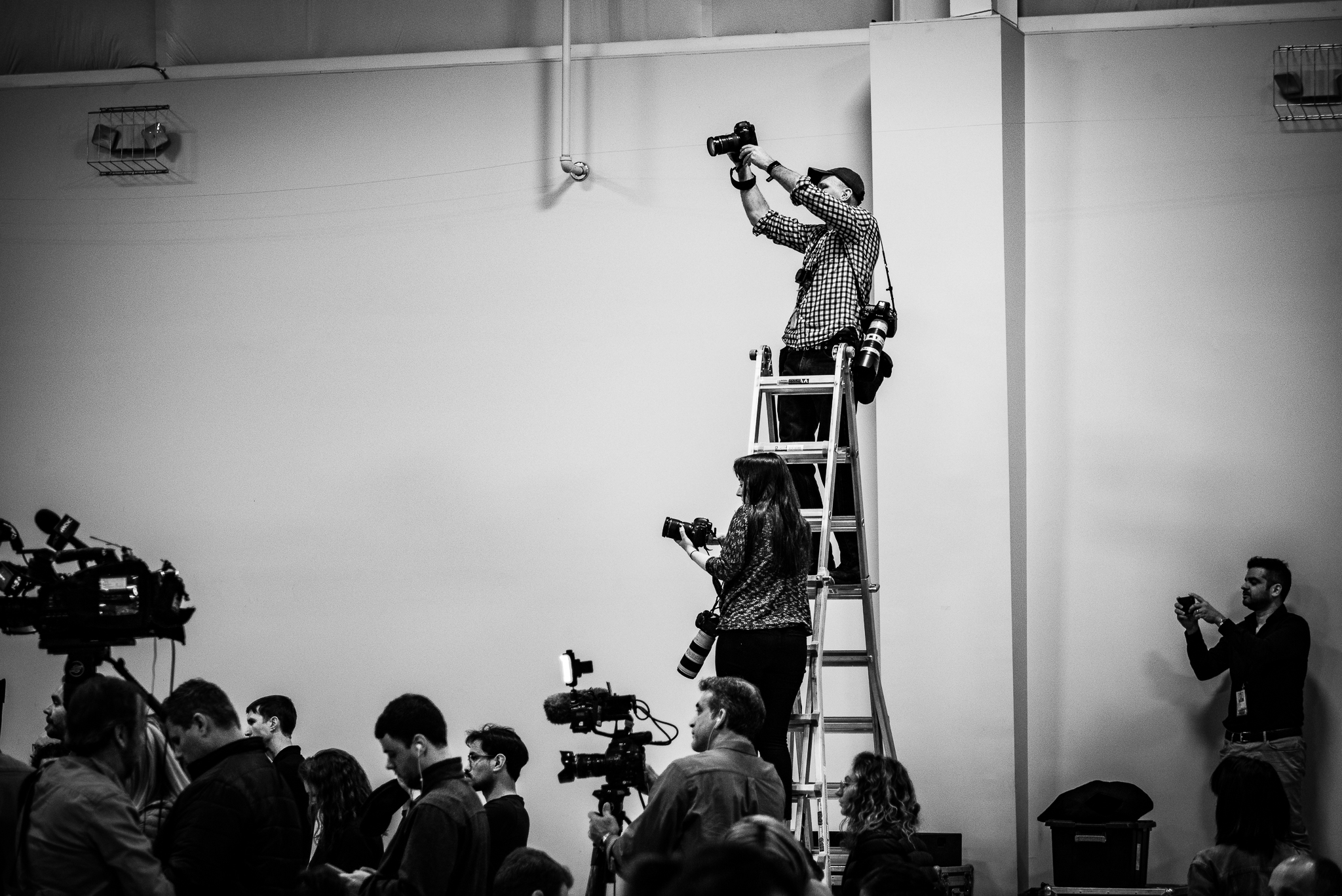National and local photographers climb a ladder at a Joe Biden rally to get a better shot of the candidate Sumter, South Carolina. Photo: Lance Monotone