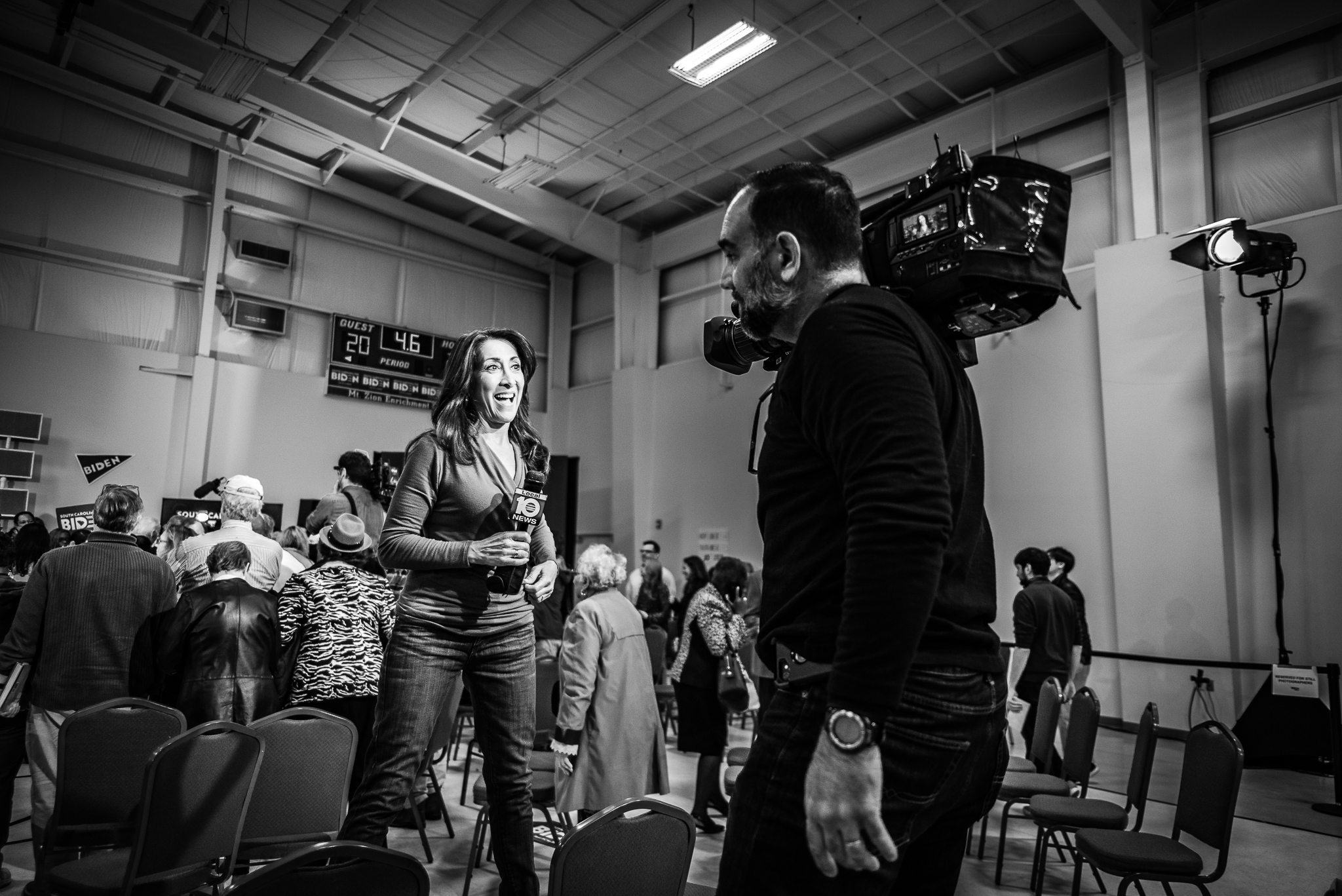 Local 10 news reporters film a segment at the end of a Joe Biden rally, wrapping up their coverage of the event. February 28, 2020. Photo: Lance Monotone.