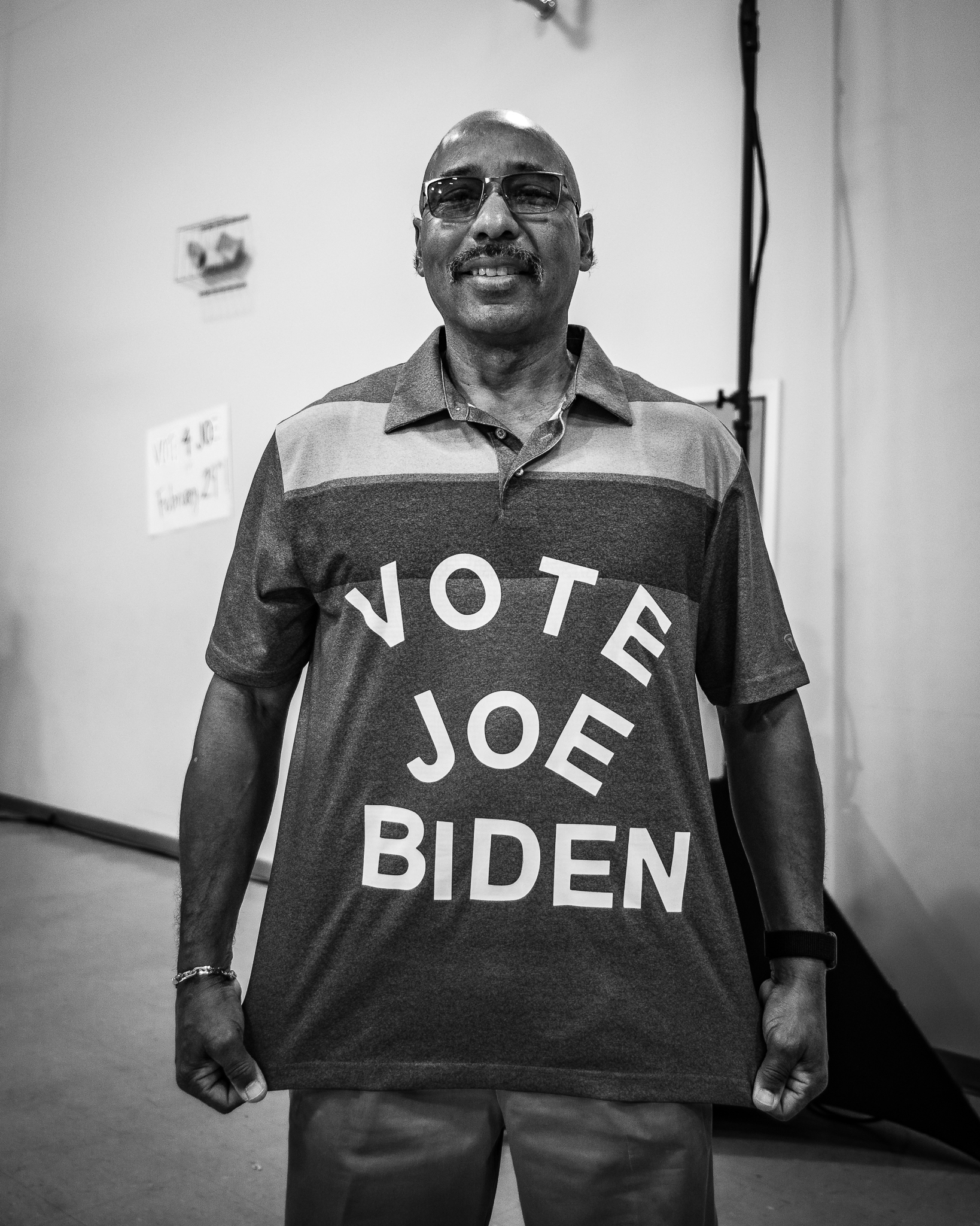 """A Biden supporter poses for a photo with a shirt that reads """"Vote Joe Biden"""" in Sumter, South Carolina. February 28, 2020. Photo Lance Monotone."""
