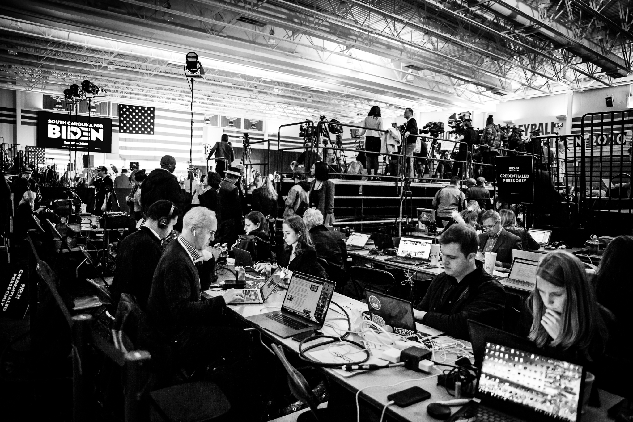 Reporters file their stories at a Joe Biden victory rally on primary night in Columbia South Carolina. February 29, 2020. Photo: Lance Monotone.