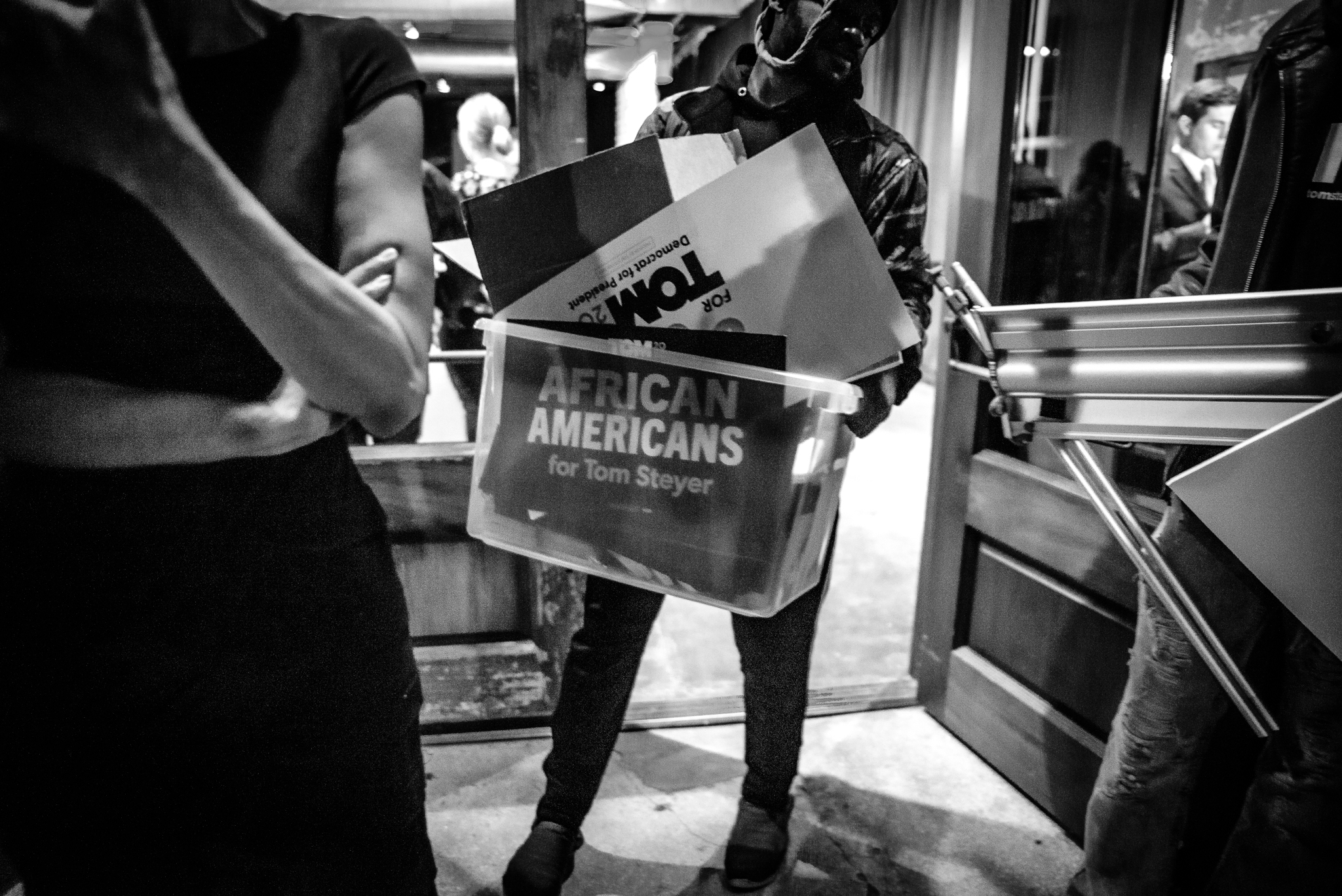 Tom Steyer's campaign team pack up their signs at a rally on primary night  in Columbia, South Carolina. February 29, 2020. Photo: Lance Monotone.