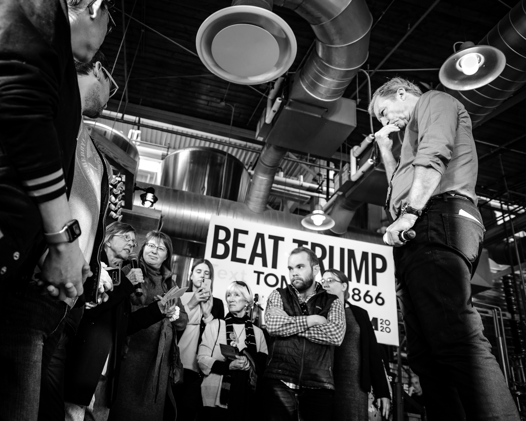 Tom Steyer takes a question from the audience at a rally in a micro-brewery in Coralville, City Iowa. February 2, 2020. Photo Lance Monotone.