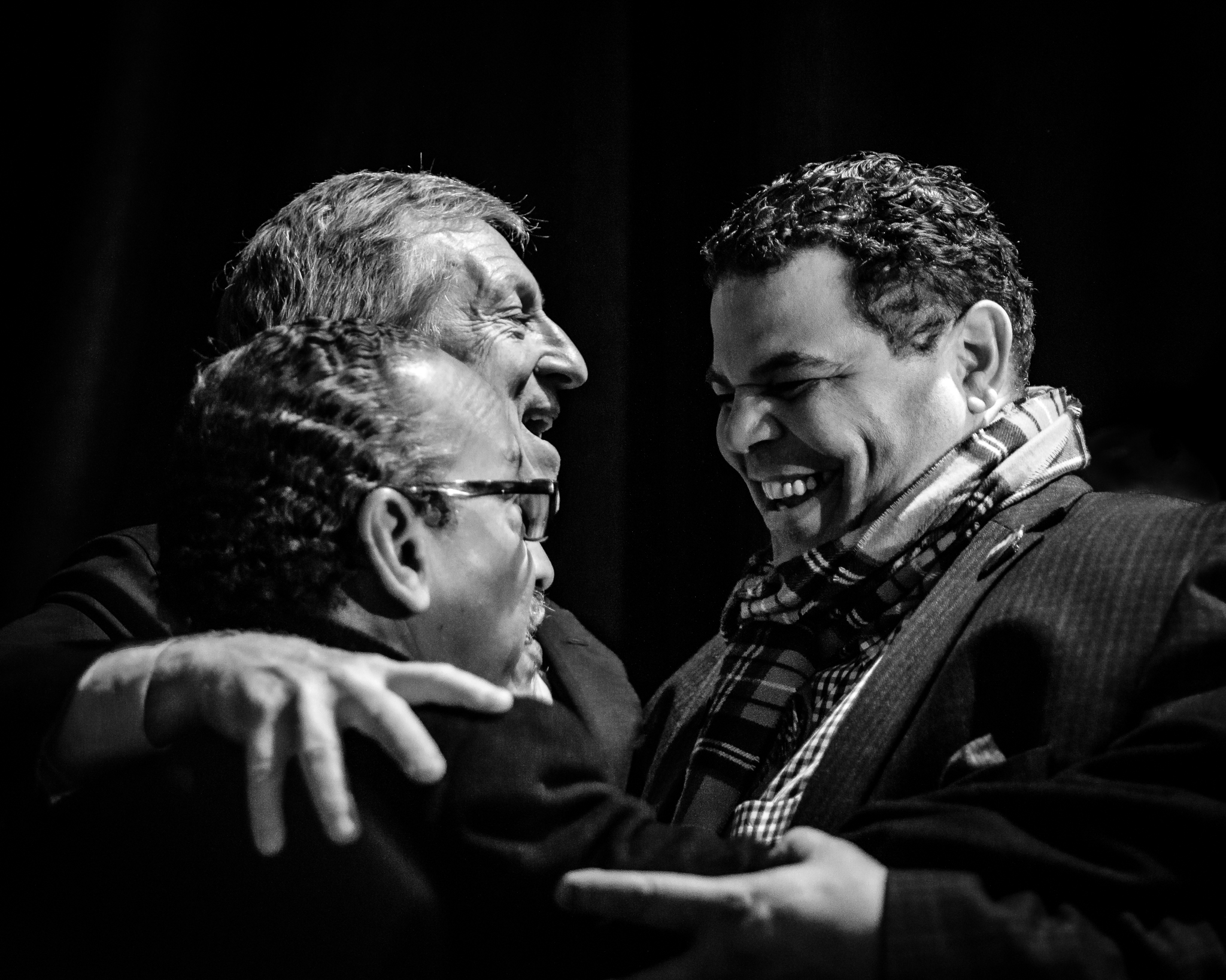 Johnnie Cordero and Tom Steyer embrace one another on stage at a rally in Columbia, South Carolina. February 29, 2020. Photo: Lance Monotone.