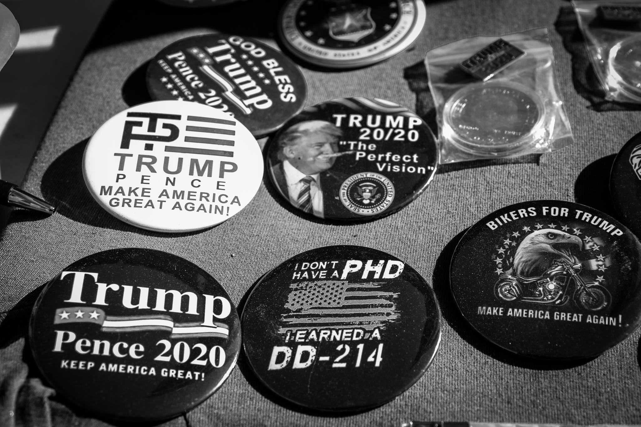 Trump buttons on display on the side of the road at a Trump rally in South Carolina. Photo: Lance Monotone.