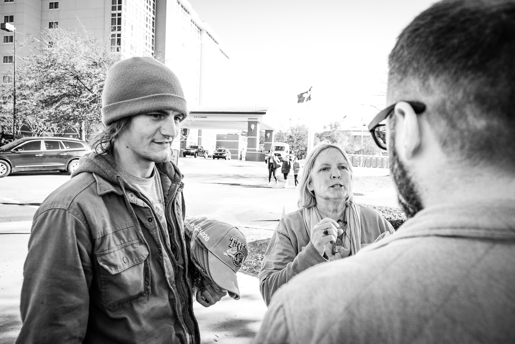 Reporter Miroslav Tomoski speaks to MAGA merchants, Tyler Tambasco and Angel Shaske, in North Charleston, South Carolina. Photo: Lance Monotone.