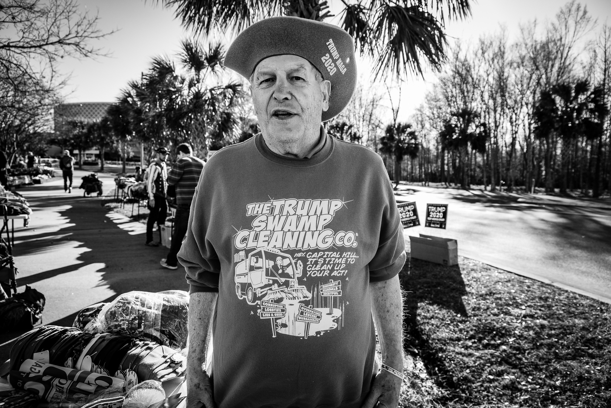 "A MAGA merchant poses for a photo showing off his shirt that reads: ""The Trump Swamp Cleaning Co."" Photo: Lance Monotone."